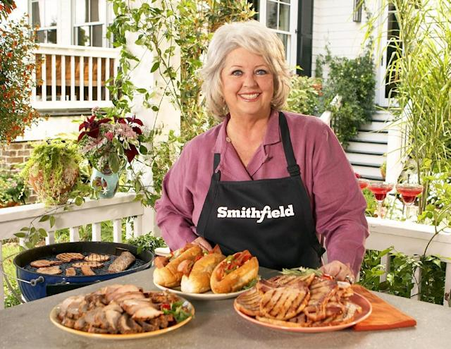 FILE - This undated image released by Smithfield Foods shows celebrity chef Paula Deen wearing a Smithfield apron as she stands in front of various Smithfield meat products. On Monday, June 24, 2013, Smithfield Foods said it was dropping Deen as a spokeswoman. The announcement came days after the Food Network said it would not renew the celebrity cook's contract in the wake of revelations that she used racial slurs in the past. (AP Photo/Smithfield Foods via PRNewsFoto)