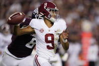 Alabama quarterback Bryce Young (9) is pressured by Texas A&M defensive lineman DeMarvin Leal (8) during the first half of an NCAA college football game Saturday, Oct. 9, 2021, in College Station, Texas. (AP Photo/Sam Craft)