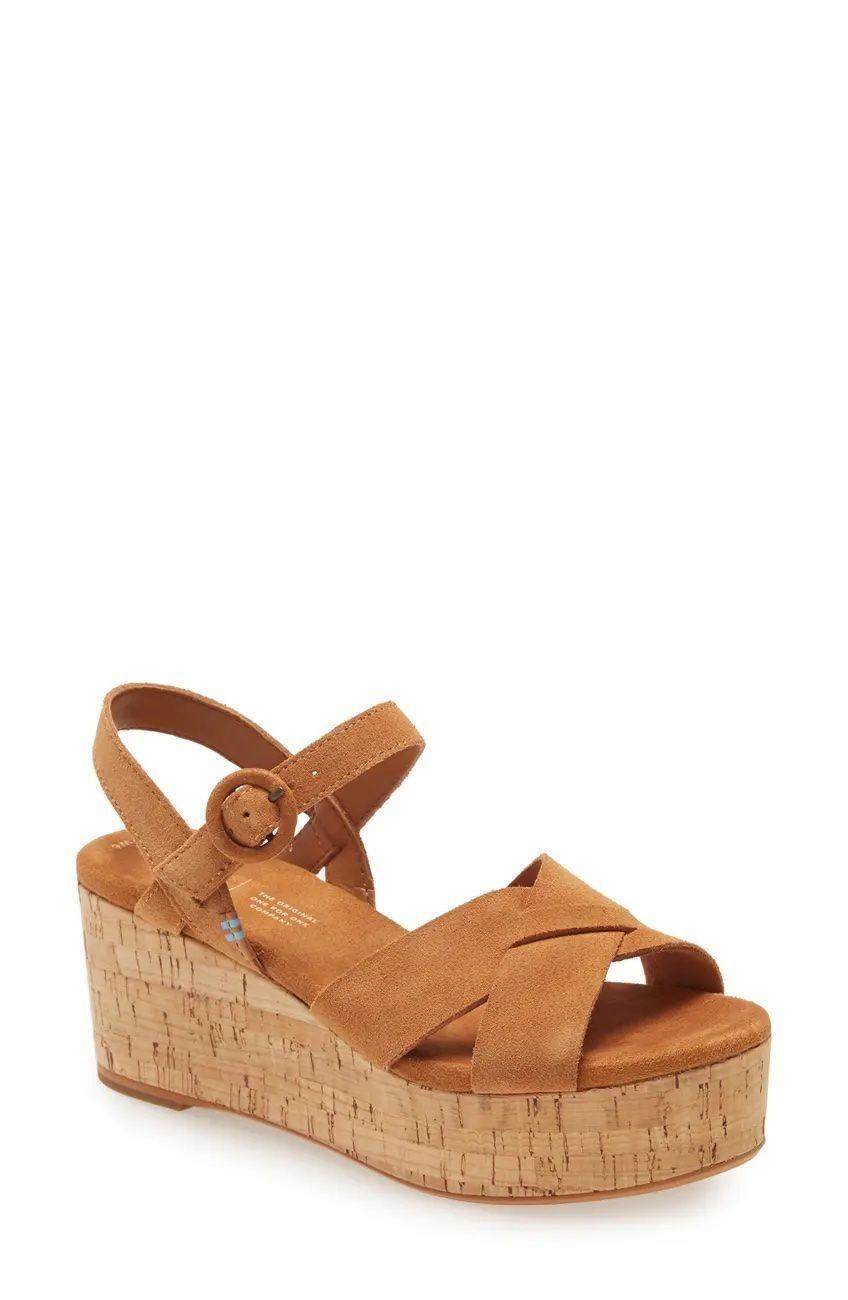 """<p><strong>Toms</strong></p><p>amazon.com</p><p><strong>$34.75</strong></p><p><a href=""""https://www.amazon.com/dp/B07TWHHY5X?tag=syn-yahoo-20&ascsubtag=%5Bartid%7C2141.g.36040203%5Bsrc%7Cyahoo-us"""" rel=""""nofollow noopener"""" target=""""_blank"""" data-ylk=""""slk:SHOP NOW"""" class=""""link rapid-noclick-resp"""">SHOP NOW</a></p><p>With a cork platform and <strong>cushioning made of plant-derived and recycled materials</strong>, you can feel good about wearing these 3-inch wedges. Plus, every time you purchase a pair of Toms, the brand gives a pair to a child in need—a win-win! </p>"""