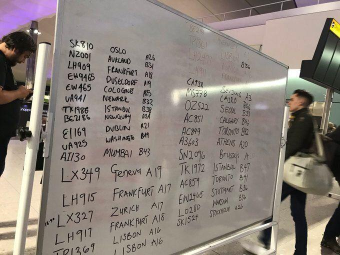 Whiteboards displaying handwritten flight numbers and destinations at Heathrow after the airport experienced technical difficulties. (Photo: PA/@JennyNielsenNPT )