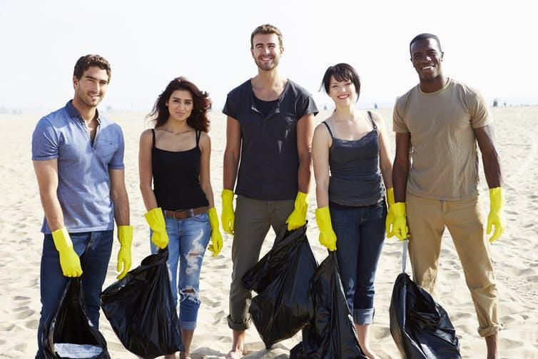 """<span class=""""caption"""">Beach cleanup events can engage communities in halting the flow of plastic into the ocean.</span> <span class=""""attribution""""><a class=""""link rapid-noclick-resp"""" href=""""https://www.shutterstock.com/image-photo/group-volunteers-tidying-rubbish-on-beach-290589398?src=VeCc7Cbypfnhwdu_imnt7g-1-16"""" rel=""""nofollow noopener"""" target=""""_blank"""" data-ylk=""""slk:www.shutterstock.com"""">www.shutterstock.com</a></span>"""