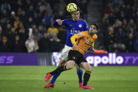 Wolverhampton Wanderers' Pedro Neto fights for the ball Leicester's Ben Chilwell during the English Premier League soccer match between Wolverhampton Wanderers and Leicester City at the Molineux Stadium in Wolverhampton, England, Friday, Feb. 14, 2020. (AP Photo/Rui Vieira)