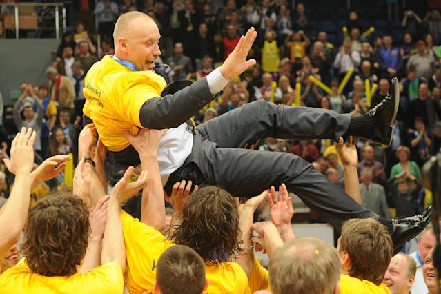 BC Khimki's head coach Rimas Kurtinaitis is celebrated by his players after winning the Eurocup final basketball match between BC Khimki and Valencia in Khimki, outside Moscow on April 15, 2012. BC Khimki won 77-68. AFP PHOTO / KIRILL KUDRYAVTSEV (Photo credit should read KIRILL KUDRYAVTSEV/AFP/Getty Images)