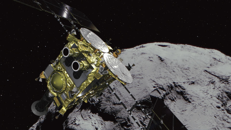 FILE - In this computer graphics image provided by the Japan Aerospace Exploration Agency (JAXA) shows an asteroid and asteroid explorer Hayabusa2. The Japanese government said Tuesday that Tokyo police are investigating cyberattacks on about 200 companies and research organizations in Japan, including one on the country's JAXA space agency by a hacking group linked to the Chinese military. (JAXA via AP, File)