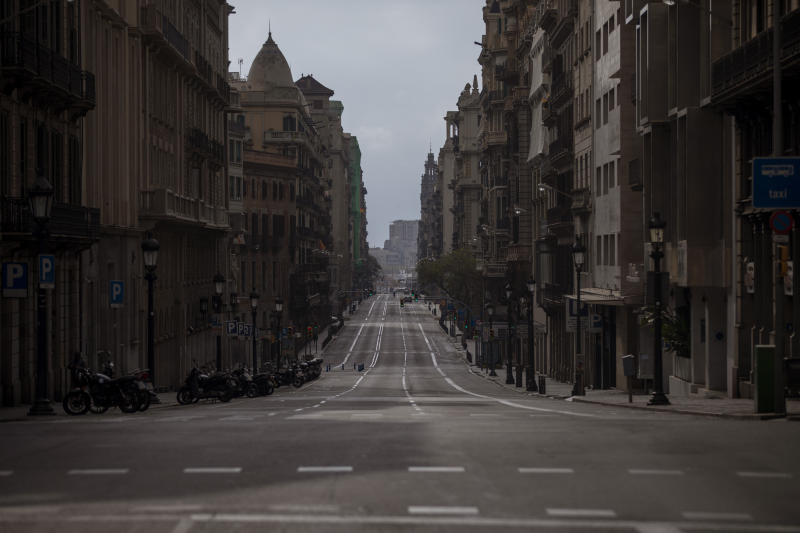 A view of Via Laietana street as authorities control public movements in Barcelona, Spain, Sunday, March 22, 2020. Spanish health authorities say intensive care units in the hardest-hit areas of Spain are close to their limit. The army was building a field hospital with 5,500 beds in a convention center in Madrid, where hotels are also being turned into wards for virus patients without serious breathing problems. For some people the COVID-19 coronavirus causes mild or moderate symptoms, but for some it causes severe illness. (AP Photo/Emilio Morenatti)