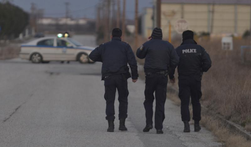 Police secure the area around a factory in the northern city of Komotini, about 800 kilometers (500 miles) northeast of Athens, Thursday, March 1, 2012. An unemployed man shot and wounded two people and took two others hostage at the plastics factory. The shooter, who was fired from the factory eight months ago, burst into the site with a with a shotgun, wounding a member of the management and another employee, police said. (AP Photo/Nikolas Giakoumidis)