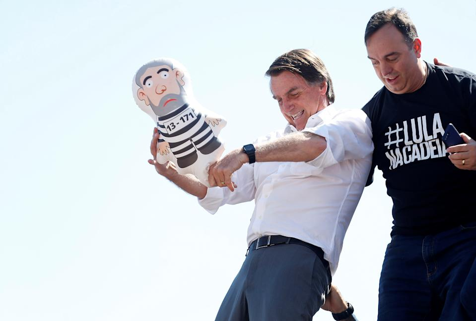 Presidential candidate Jair Bolsonaro holds an inflatable doll, also known as Pixuleco, depicting former Brazilian president Luiz Inacio Lula da Silva, during a rally in Taguatinga near Brasilia, Brazil September 5, 2018. REUTERS/Adriano Machado