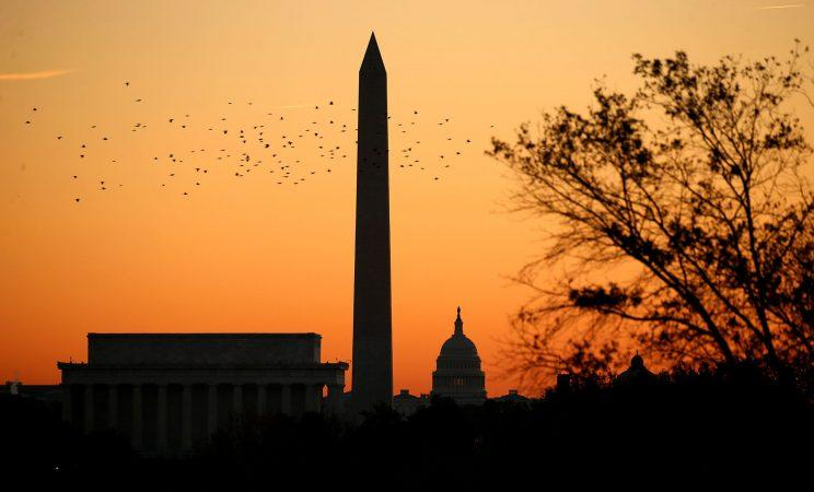 Birds fly over the Lincoln Memorial, the Washington Monument and the U.S. Capitol at sunrise on election day in Washington, November 8, 2016. (Photo: Kevin Lamarque/Reuters)