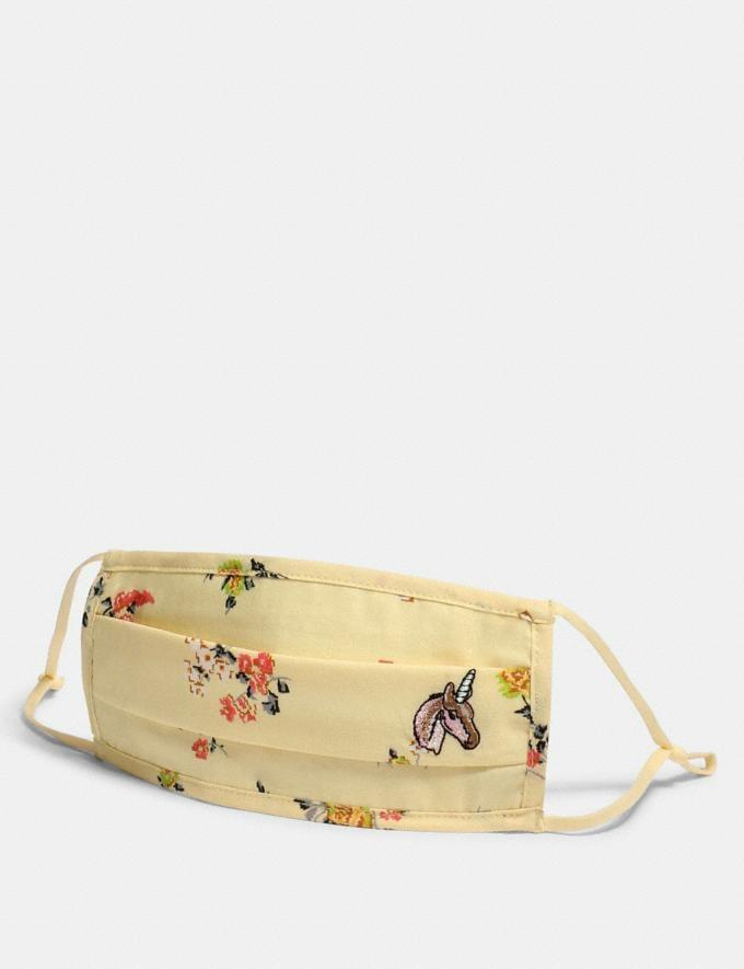 <p><span>This pale yellow, double-layered Coach face mask</span> ($18) is so pretty, you'll want to wear it everywhere! It has multicolored flowers and a tiny, embroidered unicorn on one corner. And, buying this mask helps the community - 100 percent of net profits will be donated to Feeding America.</p>