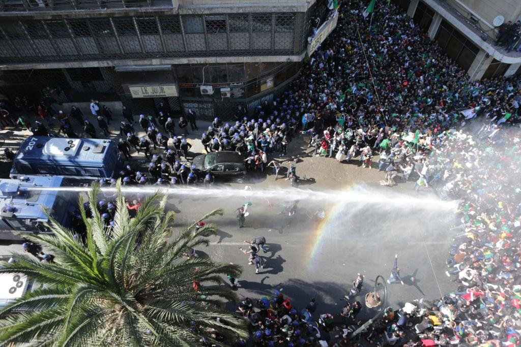 <p>Police officers intervene in protests as thousands of people stage a demonstration to demand the resignation of Algerian President Abdelaziz Bouteflika on March 29, 2019 in Algiers, Algeria.<br />(Photo from Farouk Batiche/Anadolu Agency/Getty Images) </p>