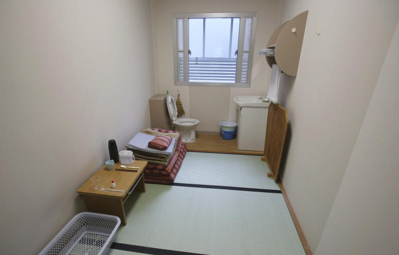 A solitary cell is opened to the media during a press tour of he Tokyo Detention House in Tokyo, Monday, June 10, 2019. Foreign media got a rare tour of the austere, drab but orderly facility Monday, although only of the floors without inmates, and photography was restricted. Each solitary cell has only a toilet, folded bedding, a shelf and a sink.(AP Photo/Koji Sasahara)