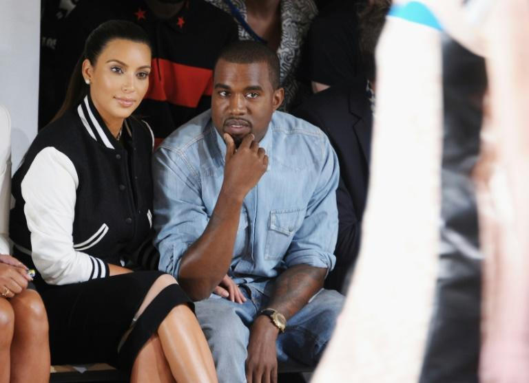 Rapper Kanye West, pictured with wife Kim Kardashian September 12, 2012, goes more gospel in new film