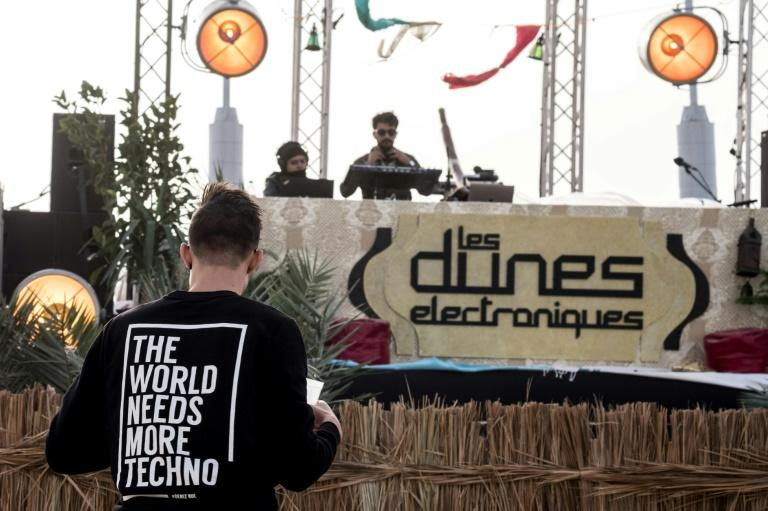 """A DJ plays at the electronic music festival """"Les Dunes Electroniques"""" at Ong Jmel, near the town of Nefta"""