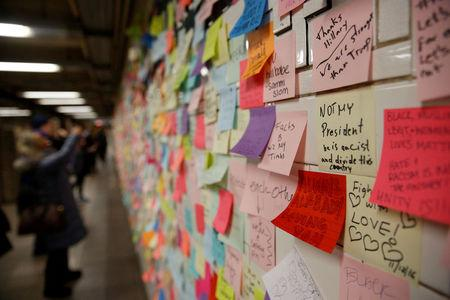Post-election Post-it notes are seen pasted along a tiled walk at Union Square subway station in New York U.S., November 14, 2016. REUTERS/Shannon Stapleton/File Photo