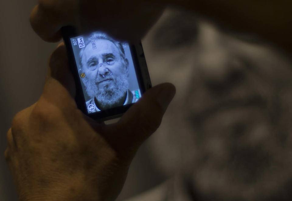 <p>A man takes a picture of a photograph of former Cuban President Fidel Castro during a photo exhibit of Castro by photographer Roberto Chile at the Jose Marti Memorial in Havana, Cuba, Aug. 12, 2014. (AP Photo/Ramon Espinosa) </p>