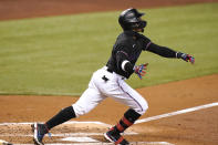 Miami Marlins' Isan Diaz watches after hitting as grand slam during the third inning of a baseball game against the Milwaukee Brewers, Friday, May 7, 2021, in Miami. (AP Photo/Lynne Sladky)