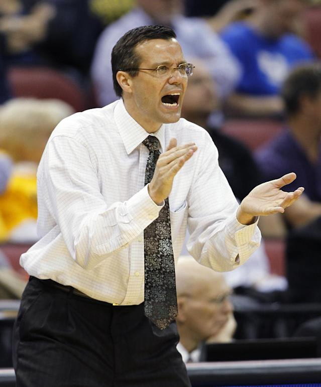 Colorado State head coach Tim Miles talks to his team in the first half of an NCAA tournament second-round college basketball game against Murray State in Louisville, KY., Thursday, March 15, 2012. (AP Photo/John Bazemore)