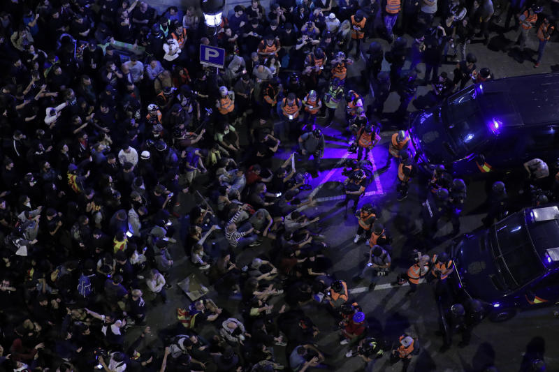 Catalan pro-independence demonstrators pack the street in Barcelona, Spain, Saturday, Oct. 19, 2019. Barcelona and the rest of the restive Spanish region of Catalonia are reeling from five straight days of violent protests for the sentencing of 12 separatist leaders to lengthy prison sentences.The riots have broken out at nightfall following huge peaceful protests each day since Monday's Supreme Court verdict. (AP Photo/Manu Fernandez)