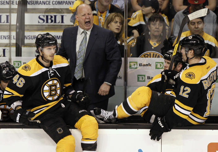 Boston Bruins head coach Claude Julien shouts out during the second period against the Washington Capitals in Game 5 in a first-round NHL Stanley Cup playoff hockey series in Boston Saturday, April 21, 2012. (AP Photo/Winslow Townson)