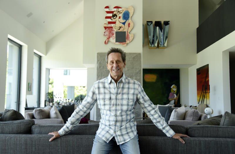 """This Aug. 30, 2019 photo shows producer Brian Grazer posing for a portrait at his home in Santa Monica, Calif., to promote his book """"Face to Face: The Art of Human Connection."""" (Photo by Chris Pizzello/Invision/AP)"""
