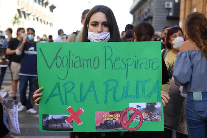 Woman in Milan, Italy, holding banner