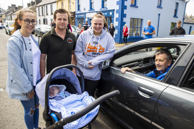Geoffrey McKillop (right) in Co Antrim meets his four week old grandson Alexander Geoffery Aaron McKillop after being discharged from Causeway Hospital in Coleraine, Co Londonderry, where he survived coronavirus. (Getty Images)
