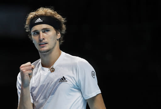 Alexander Zverev of Germany celebrates winning against Diego Schwartzman of Argentina during their tennis match at the ATP World Finals tennis tournament at the O2 arena in London, Wednesday, Nov. 18, 2020. (AP Photo/Frank Augstein)