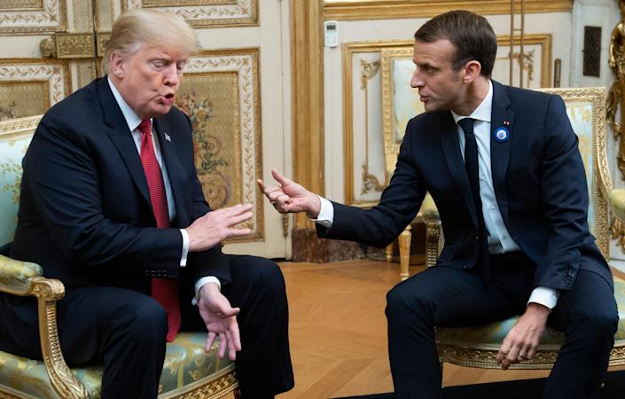 President Trump speaks with French President Emmanuel Macron before their meeting in Paris on Saturday. (Photo: Saul Loeb/AFP/Getty Images)