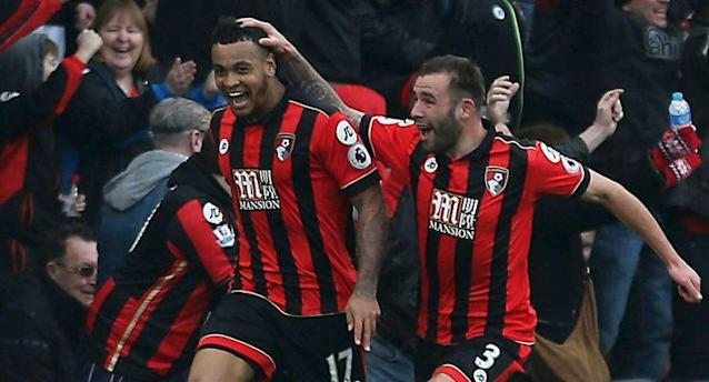 AFC Bournemouth's Joshua King, left, celebrates scoring his hat trick against West Ham United during the English Premier League soccer match at the Vitality Stadium, Bournemouth, England, Saturday March 11, 2017. (Steven Paston/PA via AP)