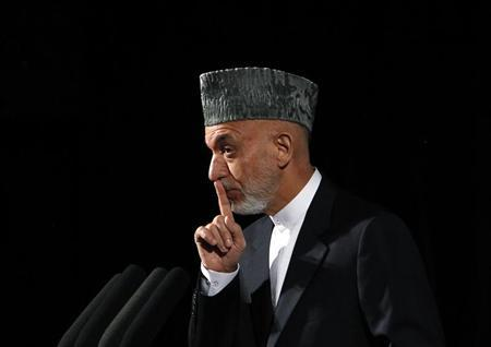 Afghan President Hamid Karzai speaks during a gathering discussing youth and national issues in Kabul September 17, 2013. REUTERS/Omar Sobhani