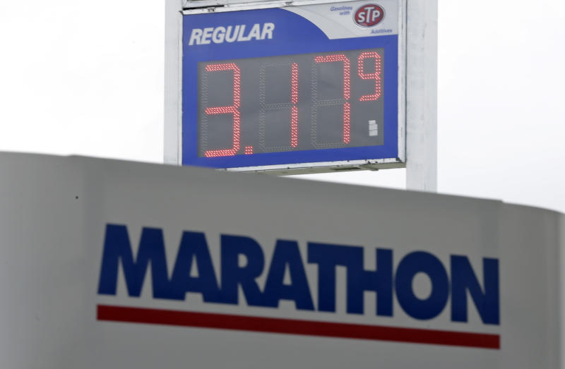 Gas prices drop to $3.17 at a Marathon station in Kokomo, Ind., Thursday, Oct. 24, 2013. Local gasoline prices are swinging up and down ever more drastically, a result of a national fuel system that is operating with a shrinking margin for error. (AP Photo/Michael Conroy)