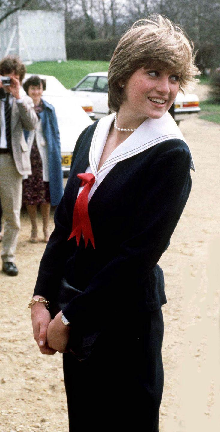 <p>This naval-inspired look is everything. Diana wore the outfit for a trip to Cheltenham complete with a sailor collar, red bow and her signature pearls.</p>