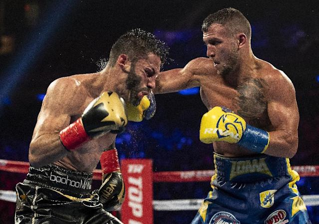 Vasiliy Lomachenko -- seen here on the way to a May 12 victory over Jorge Linares -- faces Jose Pedraza in a lightweight world title unification fight on Saturday (AFP Photo/AL BELLO)