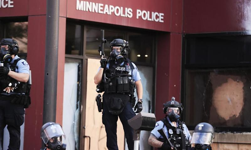 Police in riot gear outside the third precinct during protests over the death of George Floyd in Minneapolis.