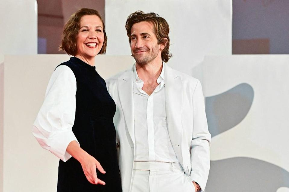 Maggie  with Jake Gyllenhaal at the 2021 Venice Film Festival (AFP via Getty Images)