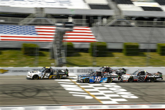 Sheldon Creed, in truck number 2, breaks away from the pack on a restart after a caution during the NASCAR Truck Series auto race at Pocono Raceway, Sunday, June 28, 2020, in Long Pond, Pa. (AP Photo/Matt Slocum)