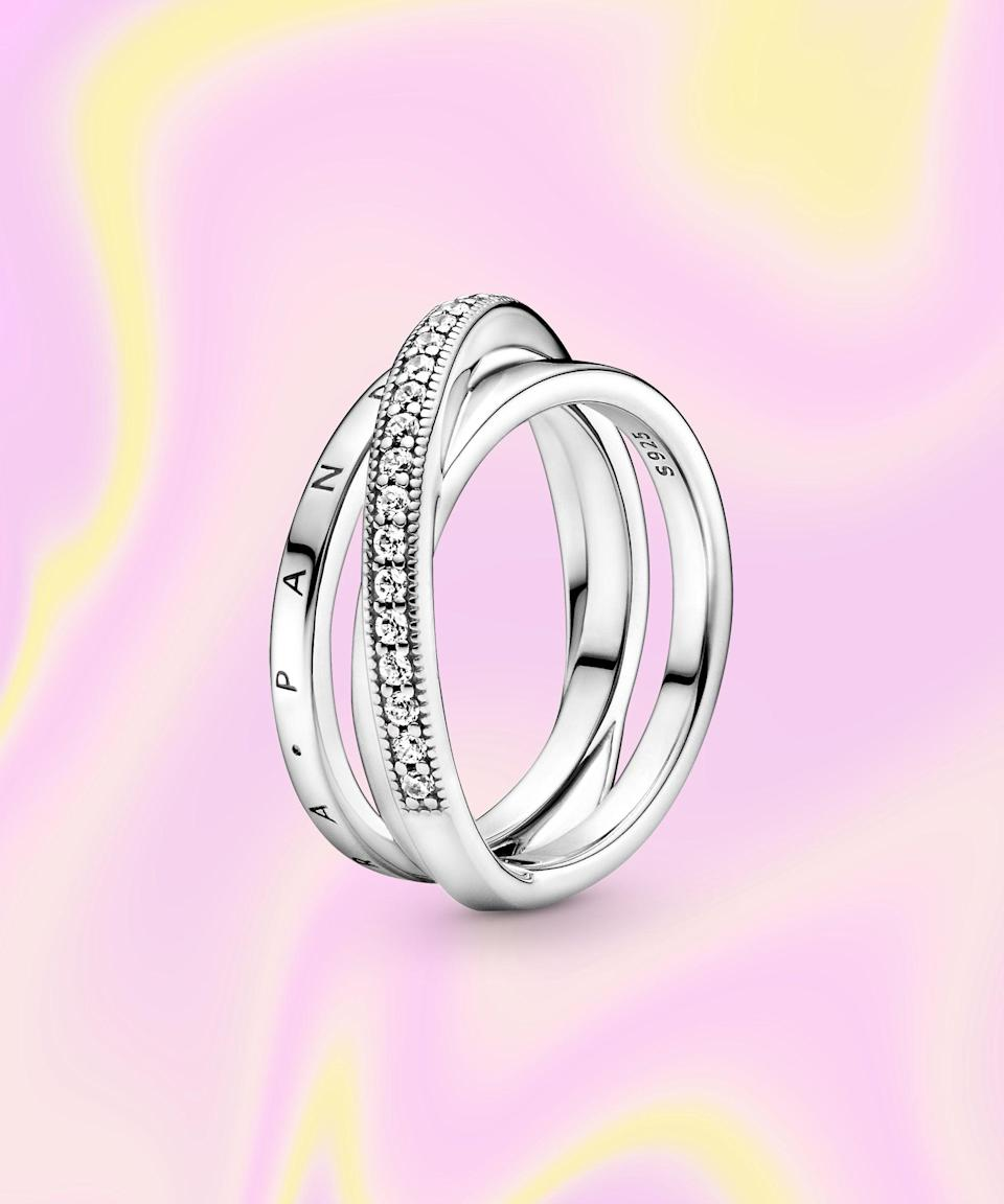 """<br><br><strong>PANDORA</strong> Crossover Pavé Triple Band Ring, $, available at <a href=""""https://go.skimresources.com/?id=30283X879131&url=https%3A%2F%2Fus.pandora.net%2Fen%2Fcollections%2Fpandora-signature%2Fcrossover-pave-triple-band-ring%2F199057C01.html%3Fcgid%3Ddiscover-collections-pandora-signature"""" rel=""""nofollow noopener"""" target=""""_blank"""" data-ylk=""""slk:PANDORA"""" class=""""link rapid-noclick-resp"""">PANDORA</a>"""