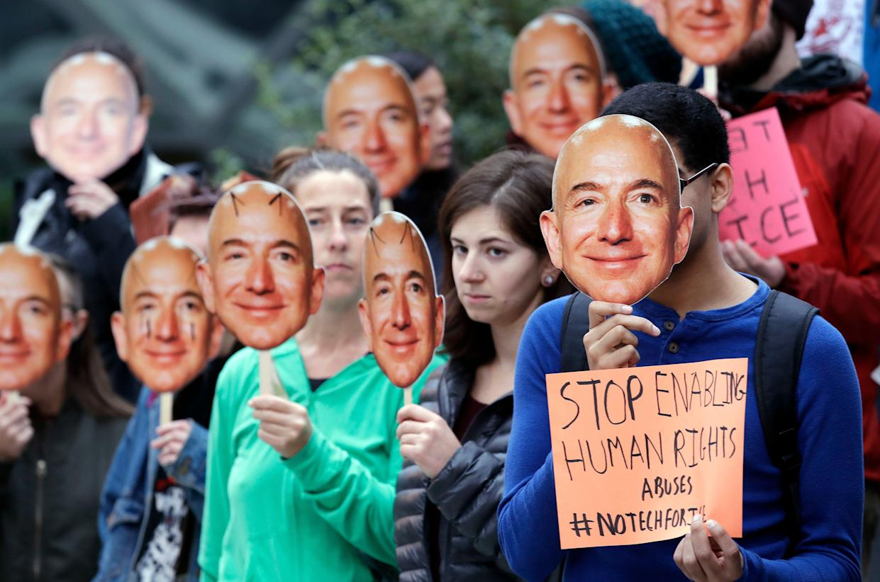 Demonstrators protest against Amazon's sale of its facial recognition technology. (Image: AP Photo/Elaine Thompson)