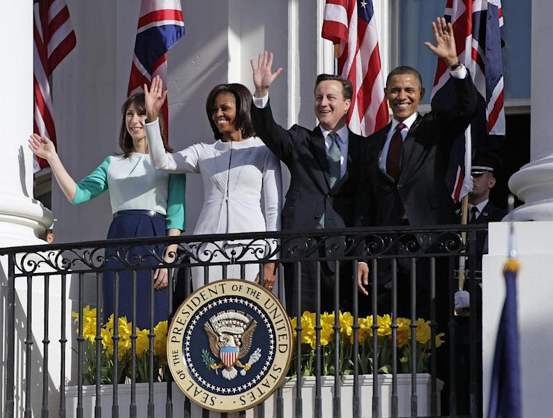 From left, Samantha Cameron, wife of British Prime Minister David Cameron, first lady Michelle Obama, British Prime Minister David Cameron and President Barack Obama wave from the balcony of the White House in Washington, Wednesday, March 14, 2012, during a state arrival ceremony on the South Lawn. (AP Photo/Carolyn Kaster)