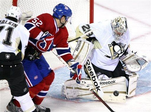 Montreal Canadiens left wing Mathieu Darche (52) is stopped by Pittsburgh Penguins goalie Marc-Andre Fleury (29) as Penguins' Evgeni Malkin (71) defends during the first period of an NHL hockey game Tuesday, Feb. 7, 2012, in Montreal. (AP Photo/The Canadian Press, Ryan Remiorz)