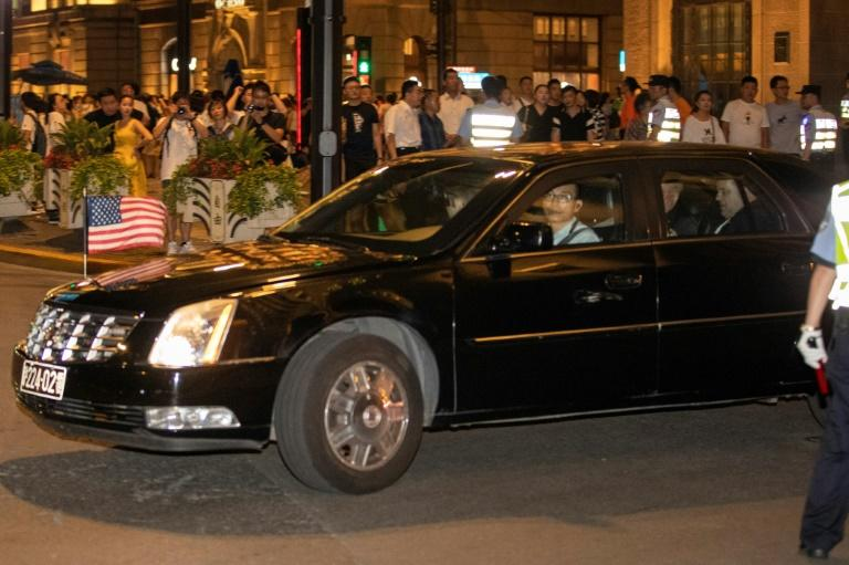 A consulate car carrying members of the US trade delegation leaves the Peace Hotel in Shanghai