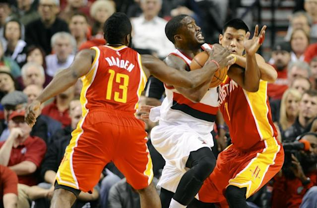 Houston Rockets James Harden (13) and Jeremy Lin (7) defend a drive by Portland Trail Blazers' Wesley Matthews (2) during the first half of an NBA basketball game in Portland, Ore.,Thursday Dec. 12, 2013. (AP Photo/Greg Wahl-Stephens)