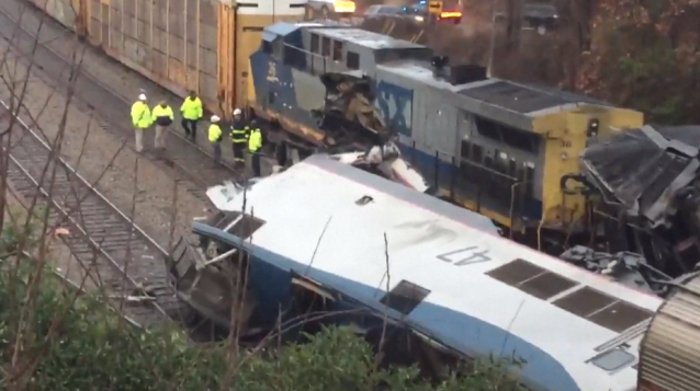 Crews assess the wreckage after an Amtrak passenger train slammed into a freight train in South Carolina on Sunday. (Photo: Getty Images)