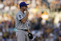 Los Angeles Dodgers starting pitcher Max Scherzer reacts while working against a San Diego Padres batter during the first inning of a baseball game Thursday, Aug. 26, 2021, in San Diego. (AP Photo/Gregory Bull)