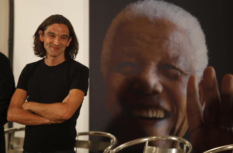 British film director Justin Chadwick during a news conference held on the eve of the South African premier of the film Mandela - Long Walk To Freedom, in Johannesburg, Saturday Nov. 2, 2013. The biographical film directed by Chadwick , is based on South African President Nelson Mandela's, on left, autobiography of the same name, which chronicles his early life, coming of age, education and 27 years in prison before becoming President and working to rebuild the country's once segregated society. British actor Idris Elba stars as Mandela, (AP Photo/Denis Farrell)
