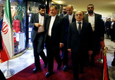 Iranian Vice President Eshaq Jahangiri and Syrian Prime Minister Imad Khamis walk together after they attended an Iranian-Syrian business forum in Damascus, Syria January 29, 2019. REUTERS/Omar Sanadiki