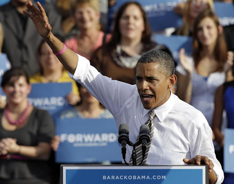 President Obama waves to supporters while speaking at a campaign event at Ybor Centennial Park in Tampa, Fla., Thursday, Oct. 25, 2012. The president is on the second day of his 48 hour, 8 state campaign blitz. (AP Photo/Chris O'Meara)