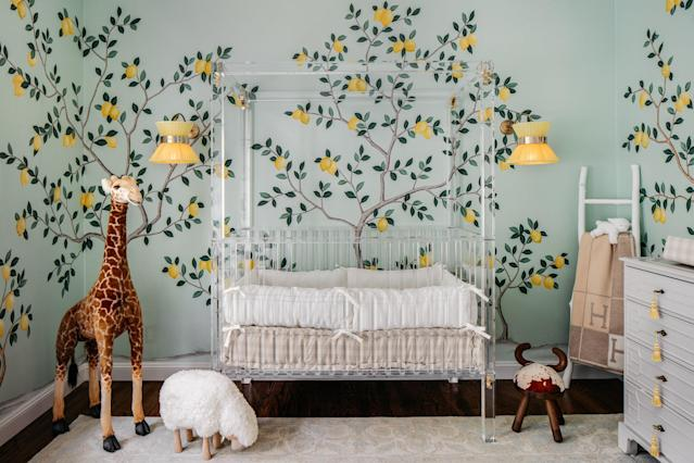 In the nursery, a continuous and well-manicured lemon orchard comes to life in hand-painted, sequin-embellished wallpaper by de Gournay—a chic and gender-neutral wall option. A lattice-work ceiling and custom Coleen & Company chandelier add to the lush garden motif, which is offset with a sleek Plexi-Craft custom lucite four-poster crib.