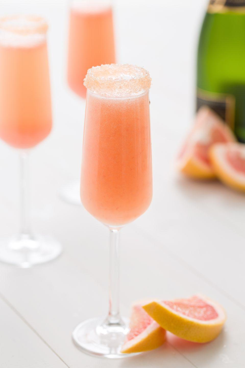 "<p>Fact: the winter citrus is served best with bubbly. This mimosa has a chic pastel rim from light pink sanding sugar.</p><p>Get the recipe from <a href=""https://www.delish.com/cooking/recipe-ideas/recipes/a46971/grapefruit-mimosas-recipe/"" rel=""nofollow noopener"" target=""_blank"" data-ylk=""slk:Delish"" class=""link rapid-noclick-resp"">Delish</a>.</p>"