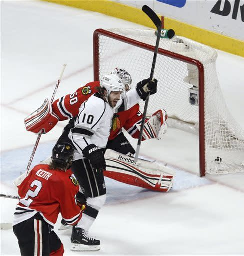 Los Angeles Kings center Mike Richards (10) celebrates after scoring a goal with a deflection against Chicago Blackhawks goalie Corey Crawford (50) during the third period in Game 5 of the NHL hockey Stanley Cup playoffs Western Conference finals, Saturday, June 8, 2013, in Chicago. (AP Photo/Charles Rex Arbogast)